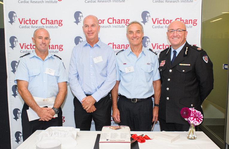 Senior Fire fighter Damien Parker, Alan Gore (cardiac arrest survivor), Senior Firefighter Brad Dives and Fire & Rescue NSW Assistant Commissioner, Paul McGuiggan.