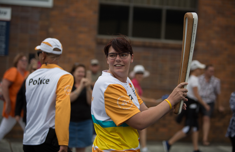 Batonbearer Jennefer Trott carries the Queen's Baton in the relay through Forster.