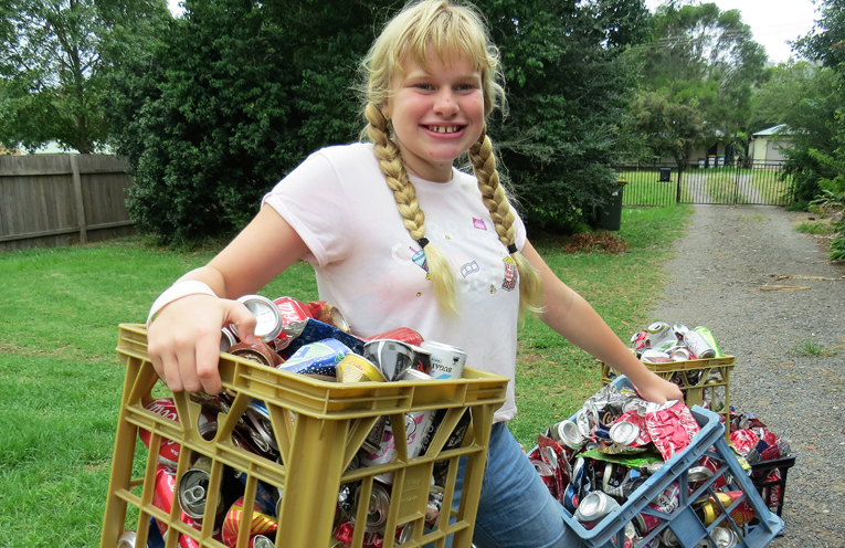 Maggie Cunich with some of the containers she has collected.