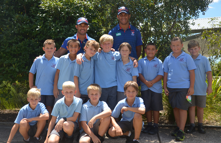 KNIGHTS VISIT: NRL's Jacob Saifiti and Christian Hazard with Tea Gardens Primary School Students.