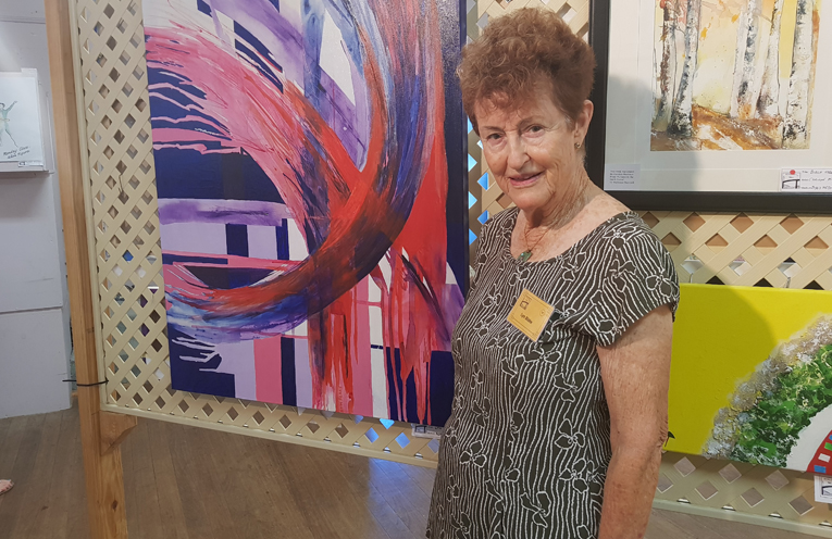 U3A ART CO-ORDINATOR: Lyn Blake with one off her works.