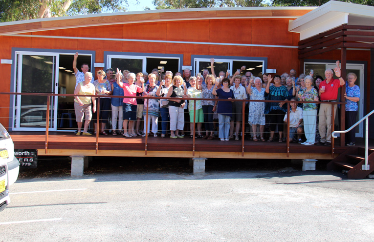 Members of the Hawks Nest Bridge Club celebrate the completion of their new community building.