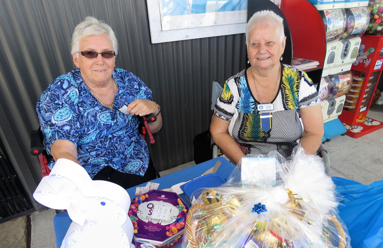 CWA members Jean Frater and Lore Green raise funds.