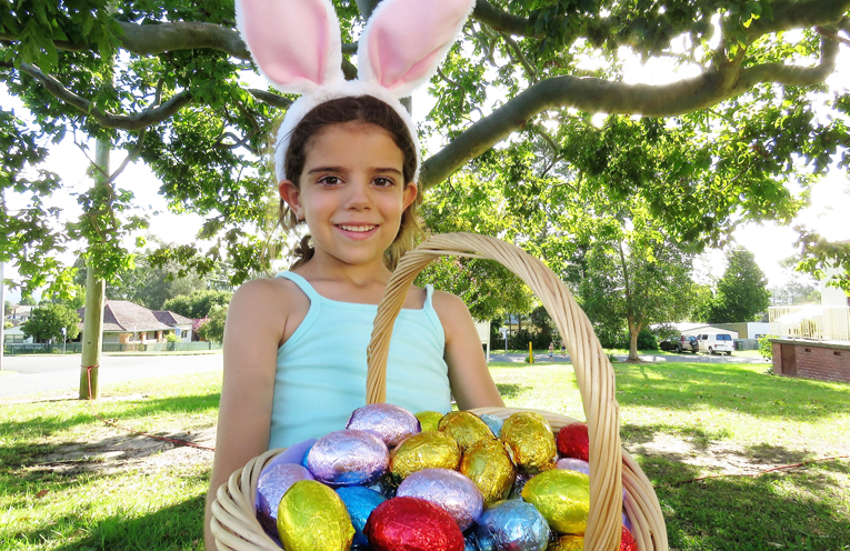 Abbiegail Ray enjoys collecting eggs left by the Easter Bunny.
