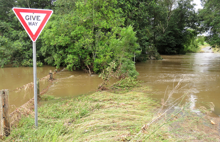 Water covered the road near Battles Bridge at Markwell.