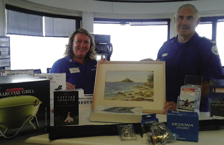 Marine Rescue members Seleana Powell and Trevor Moxon with their raffle prizes.