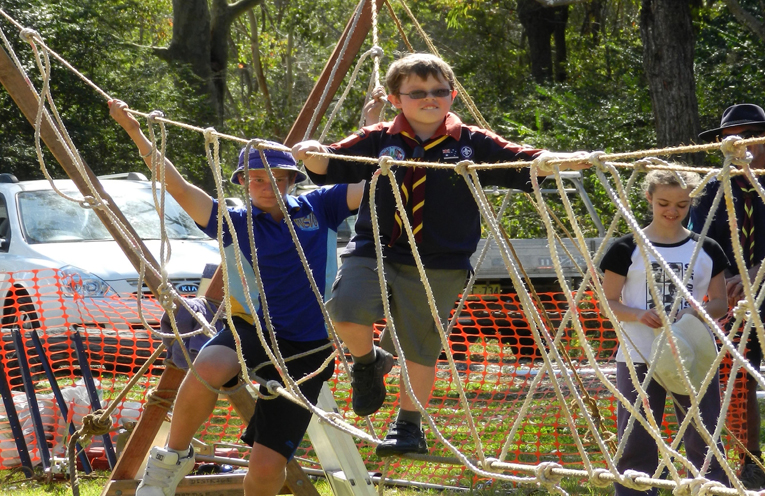Ethan Walker trying his hand at the ropes bridge at an adventure day.