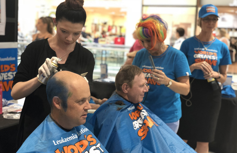 Senior Constable Luke Rogers and Chief Inspector Tony Townsend in the hairdressers chair for a great cause.