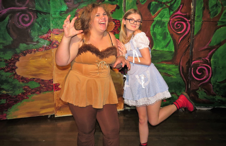 Lion Katie Nolan and Scarlett Battle as Dorothy.