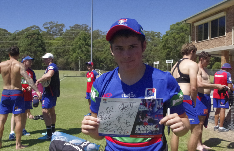 Dylan Fry with his signed Knights memorabilia. Photo by Marian Sampson.