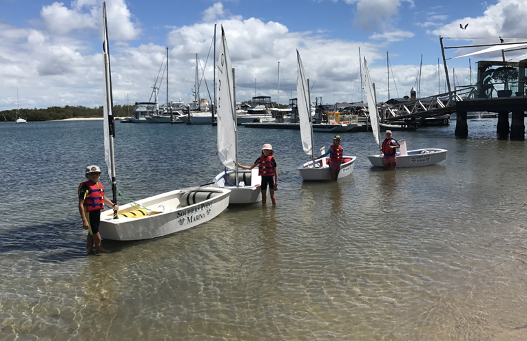 Freddie Gravenor, Tilly Gravenor, Emily Brill, Chad Butterworth enjoying a lesson through the scholarships at the Soldiers Point Sailing School.