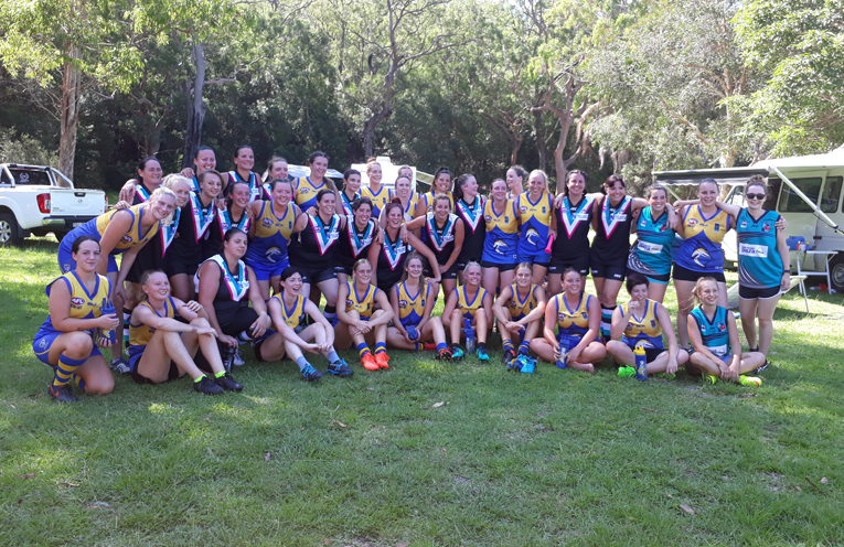 Friends in football - The Port Power, Coffs harbour and Nelson Bay girls after their friendly match.