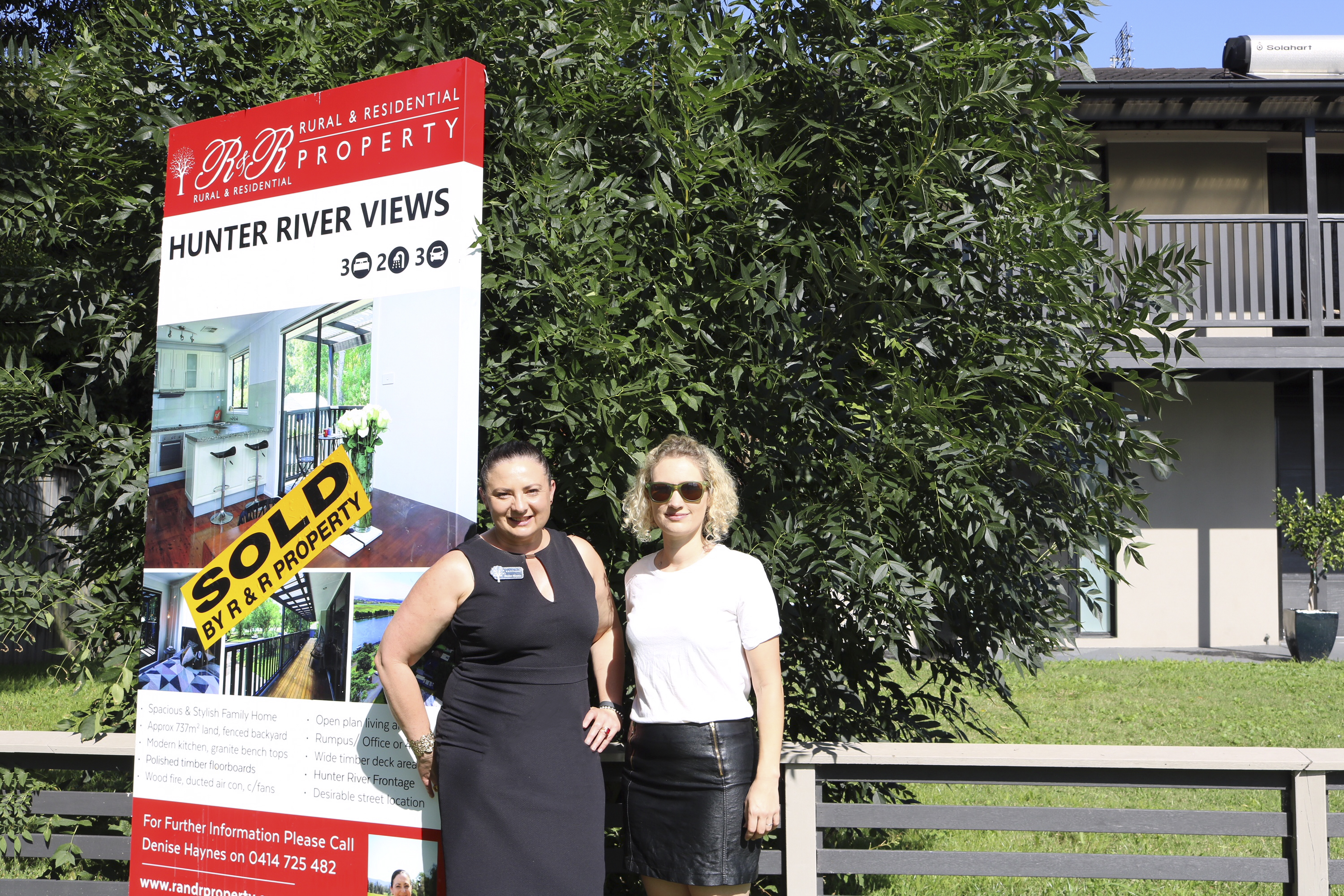 R&R Property Agent Denise Haynes and Rochelle Timony-Wright just stuck the sold sticker on.