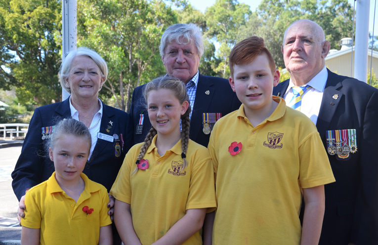 Tea Gardens RSL sub-branch members Jenny Ross-Henry, Bob McMaster and Ray Prigg with student Izabella Pollock, Simone Miller and Gethyn Bryant.
