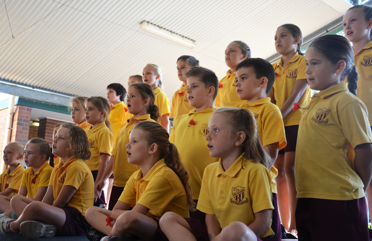 Tea Gardens school choir sang 'Can You Hear the Children Marching' during the service.