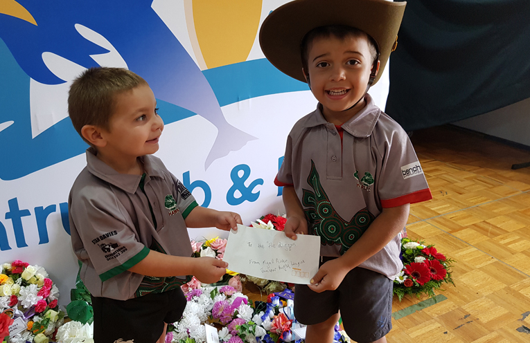 RSL DONATION: Ayce and Cruz donate $100 from the Myall River Junior's Under 6's.