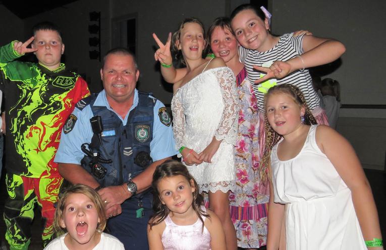 Senior Constable Trevor McLeod enjoying the Blue Light Disco.