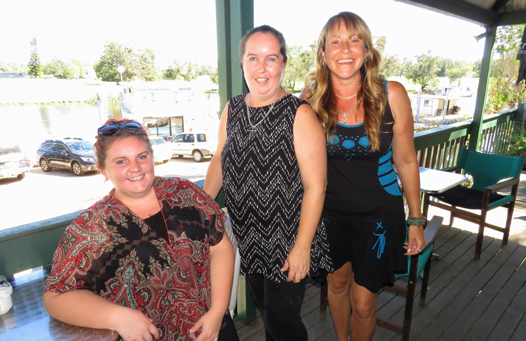 Maddie Harvey and Stacey Brown with customer Christine McAlpine on the final day of trading at the Riverside Cafe.