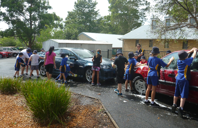 Raising funds for Cambodian school children by washing cars.