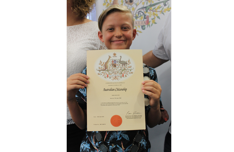Dylan Kruger with his citizenship certificate.