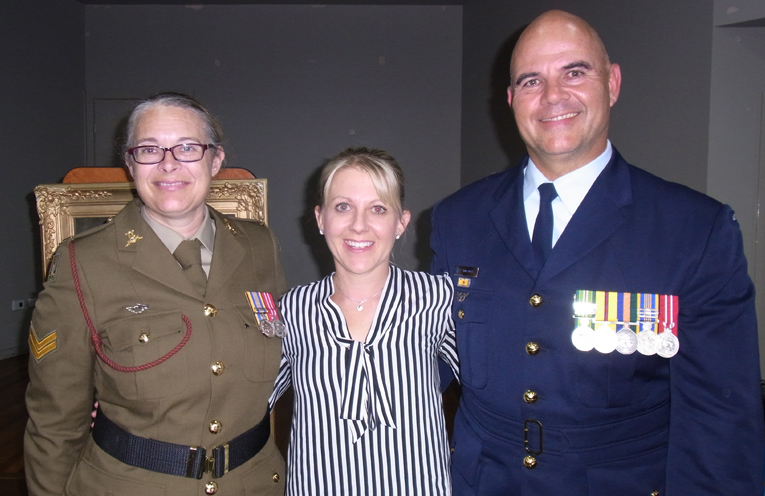 Bugle Cpl Meredith Wilson, with RAAF Warrant Officer Rudi Vitasz and his wife Natalli.