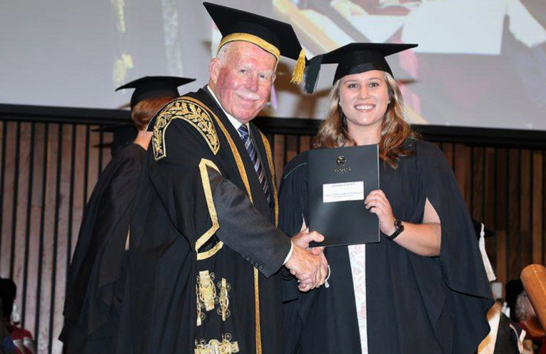 Casey Gooch received her degree from Chancellor Paul Jeans. Photo: Supplied