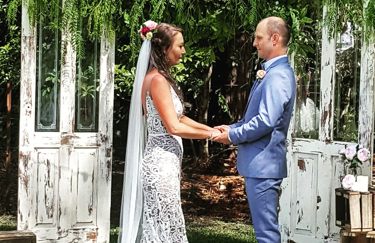 The wedding ceremony in their vintage setting.