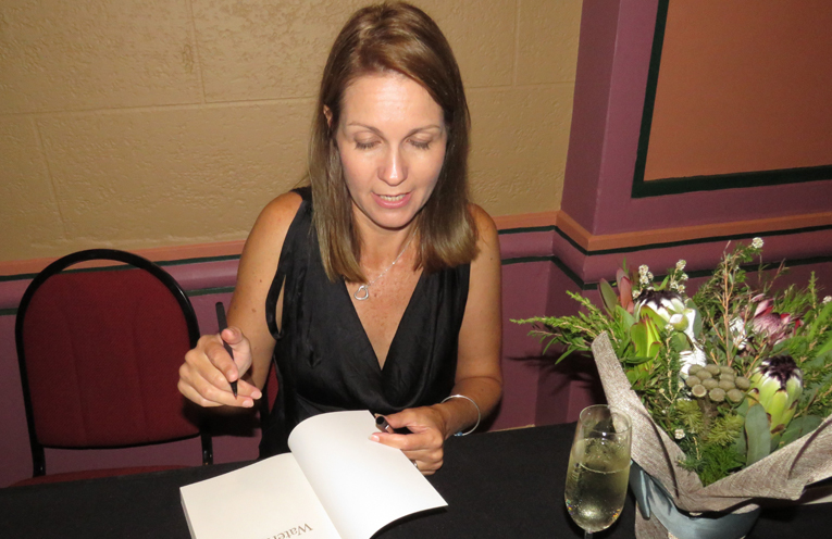Author Joanna Atherfold Finn autographing copies of her new book.