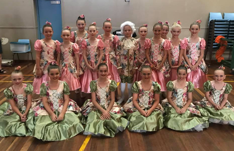 Robyn Yvette under 10 dancers in costume for the Ooh La La Eisteddfod.