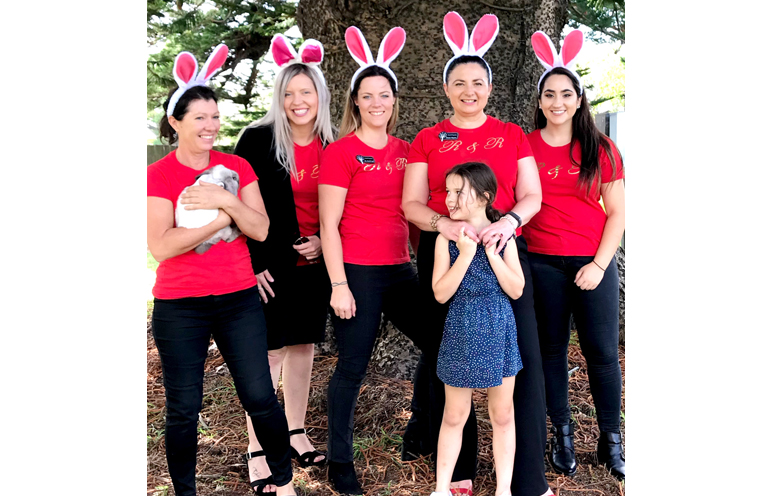 The generous staff at R & R Property who hosted the Community Easter egg hunt and fun day