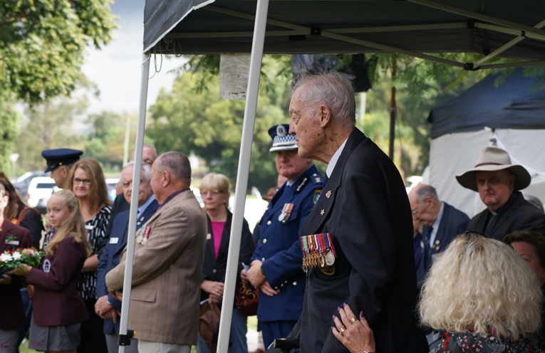 Mr James Page: an emotional moment as the tribute is read about him during the wreath laying component of the Raymond Terrace Anzac Day main service.   Photo by Stelbel Photography