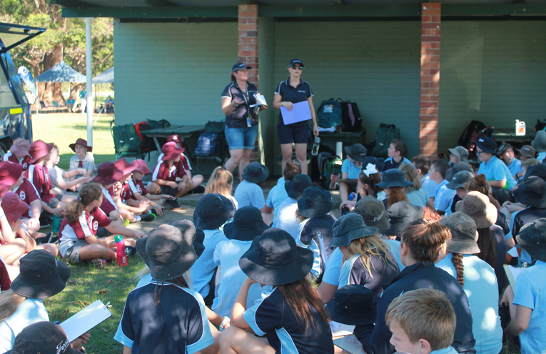 Students from Grahamstown Public School and Raymond Terrace Public School listening to instructions from staff.