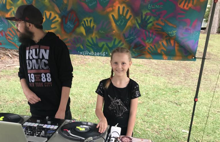 Maddison Coglan, 8, learning the DJ ropes.