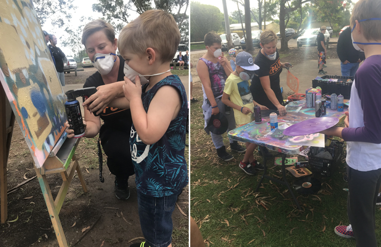 Harvie Staader, aged 2, trying his hand at spray painting. (left) One of the art stations for young people to personalise a vinyl. (right)