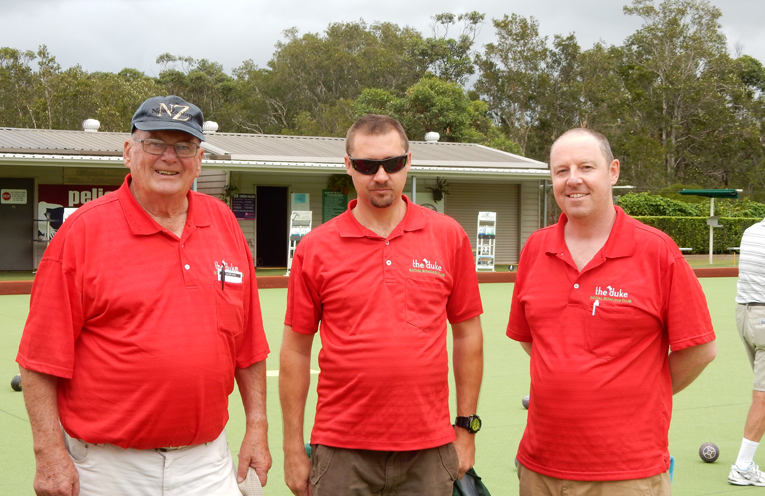 """Patron of the Men's Bowling Club, on left, with two players from the """"Duke of Wellington"""" Social Club."""
