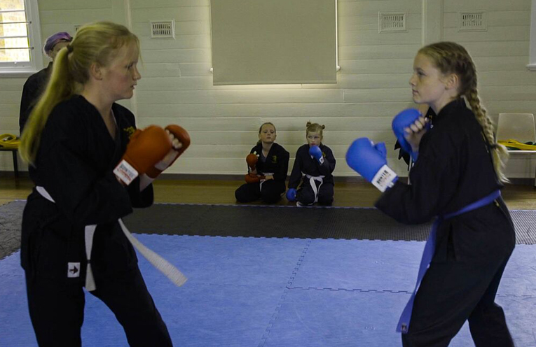 Keira (right) focuses in on her opponent.