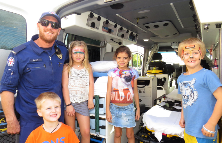Paramedic Grant Crabb shows children the inner workings of the ambulance.