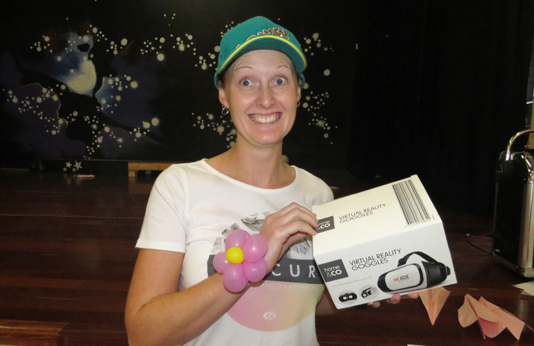 Jess Gordon won the adult section of paper plane contest.
