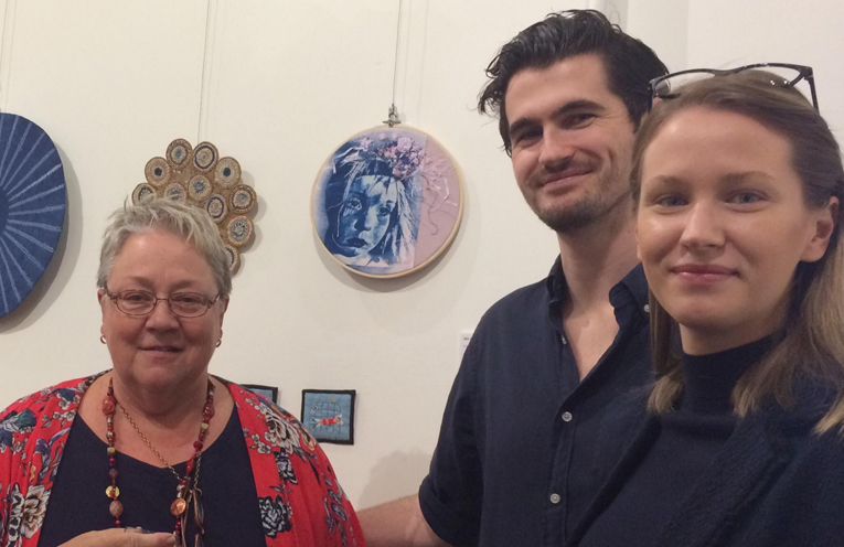 Judith with her son Alistair and his girlfriend Krystle, by her artwork 'Amelia'.