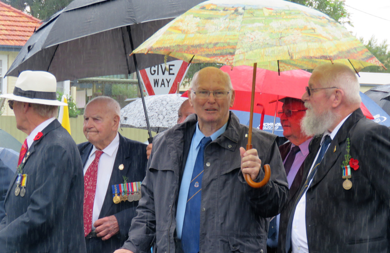 Jack Ireland stands with Bulahdelah RSL sub-branch members Max Burrows and Trevor Head.
