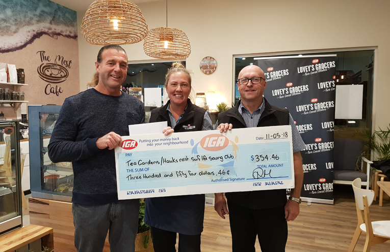 REWARDS DONATION: Steven Howell, Store Manager Colleen Ross and Co-Owner Peter Trappel.