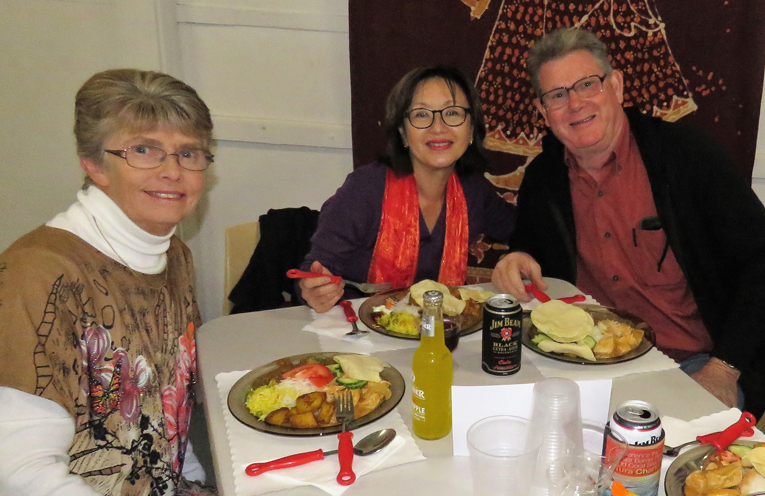 Guests enjoying dinner at the curry night.