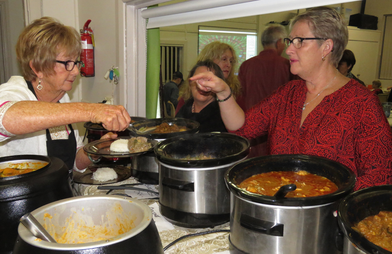Curry in a hurry: Jane Carryer serves the guests.