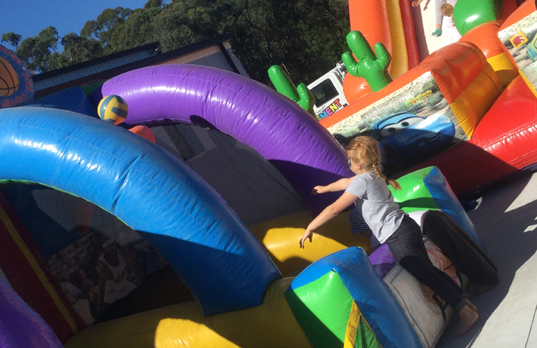 Free jumping castles were a hit with the whole family at the grand opening.