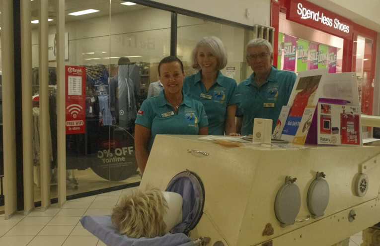 Salamander Bay Rotarians Megan Hayne, Lorrence Salter and Darcy Geale (President) with the working Iron Lung used to keep people alive while paralysed with Polio in the 1950's. Photo by Marian Sampson.
