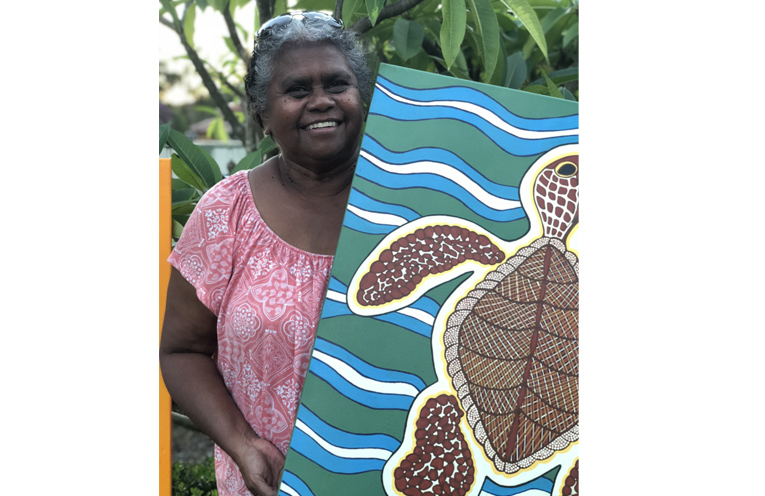 Jocelyn Archer with her painting of a Salt Water Turtle.