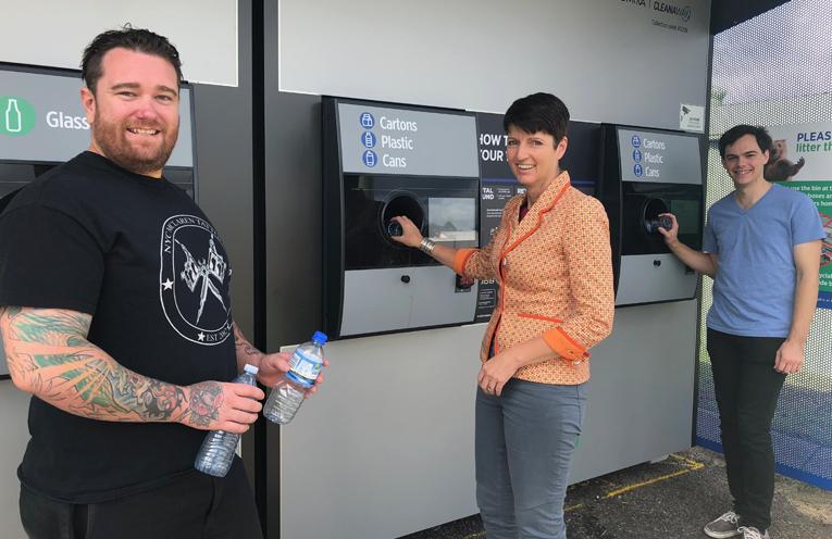 Nicholas McLaren inspects the new Raymond Terrace machine with Kate Washington MP and West Ward Councillor Giacomo Arnott.