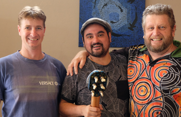 Andrew Duncan of ASD Guitars Australia, Musician Somerset Barnaby with 'Guwiyn' the guitar, and Indigenous Artist Peter Kafer.