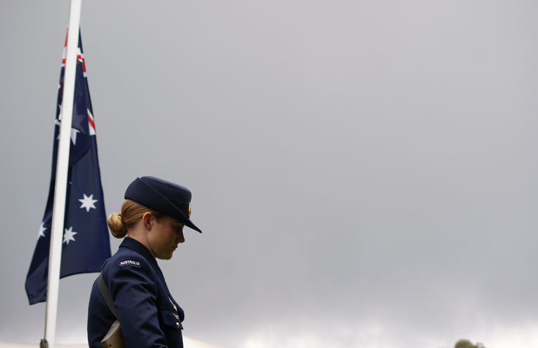 A member of the official party stands at her post.