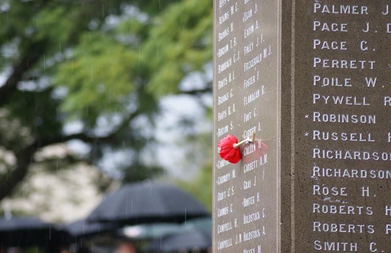 A red poppy placed next to a name on the list of Soldiers from Raymond Terrace who served.